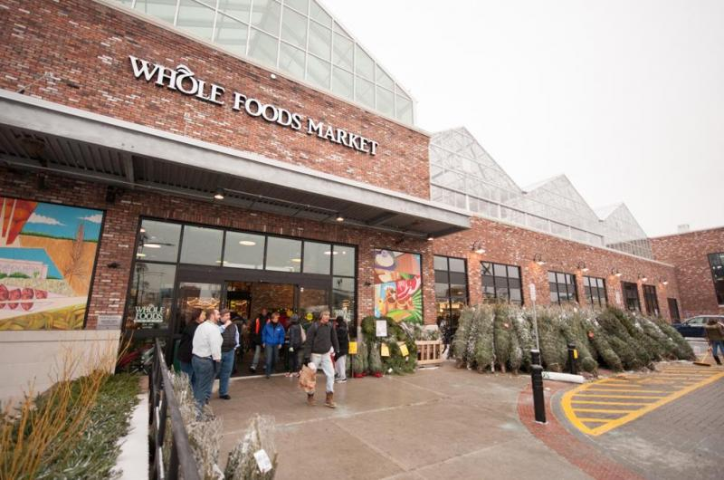The four mural panels provide a colorful addition to the front of the flagship Brooklyn Whole Foods Market.
